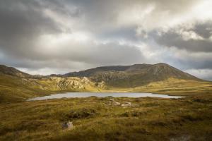 Sonnenflecken an Loch na Gainmhich, Northwest Highlands Fotoreise